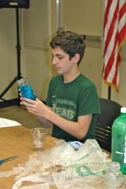 "Joey Fortin flips his jellyfish in a bottle around while sporting this year's Summer Reading Program's ""Groundbreaking Reads"" T-shirt. Participation in the program has continued to increase in recent years."