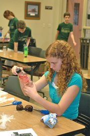 Philomena Fortin inspects her jellyfish in a bottle at Monday's Teenopolis program.