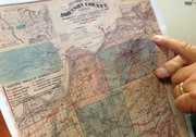 Terry Love, vice president of the Monticello Community Historical Society, points to the California Road on a historical map of Johnson County. The road ran through what is now downtown Shawnee and west through Monticello toward Lawrence.