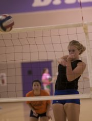 Bulldog Jordan Hoffman spikes the ball during Thursday BHS volleyball practice. The junior, who has committed to play volleyball at Washburn University, is one of a trio of heavy-hitting Bulldogs with juniors Alexia Stein and Corey Valentine who give the team strength at the net.