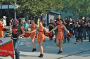 The Bonner Springs High School Marching Band and dance team walk in the 2013 Tiblow Days parade.