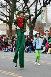 Claire Gurley walks on her stilts in North Kansas City's Snake Saturday parade earlier this year.