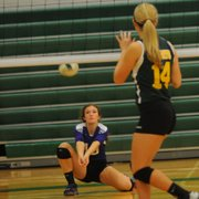 Sophomore Kelsey Kehl digs a serve in Baldwin's tournament-round match against Basehor Linwood. The Bulldogs defeated the Bobcats to avenge a season-opening defeat.