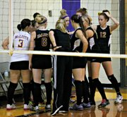 The McLouth High volleyball team breaks a huddle before its match against Veritas Christian School.
