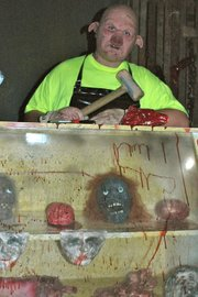 "Austin Clouse is better known as ""Leroy Pig,"" a ghastly butcher at the 3rd Street Asylum."