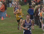 Dakota Helm (front) sets the pace for Baldwin runners Ethan Hartzell and Joe Pierce in the boys 5K race.