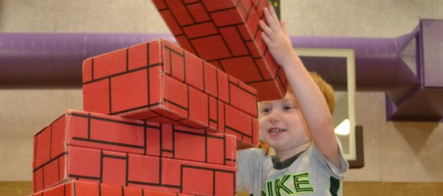 Jack Barker adds one more brick to his tower last year at BLOCKFest, sponsored by the USD 458 Parents as Teachers program.