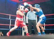 Stella Ridihalgh, left, blocks a punch by Leena Ramana.