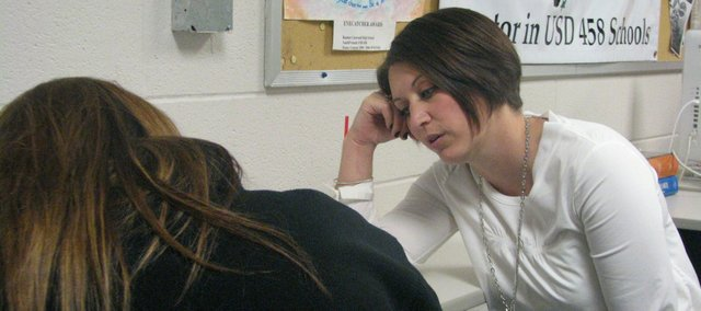 Jessica Langley (right) works with McKinzie Morche on algebra homework. Langley has been Morche's mentor for two years.