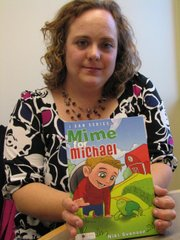 "Nicole Svinson of Basehor holds her new childrens book ""Mime for Michael."""