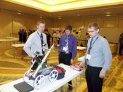 Ben Williams, left, surveys the K-State Chem E Car at a national competition this past month in San Francisco.