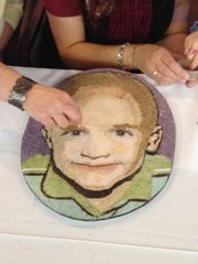 Noah Davis' family recently helped put the finishing touches on his Rose Bowl floragraph portrait at the Midwest Transplant Network's offices in Mission.