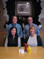 Bill and Diane Buchholz (left) with Howard Hall and Tracey Tripp-Smith at Kelley's Grille and Pub recently. The restaurant is in its 17th year feeding Basehor and surrounding communities.