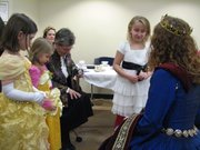 (From left) Bryn Rogers, 7, Grace Brandenburg, 4, and Sarah Mock, 7, talk to a princess from the Kansas City Renaissance Festival.