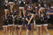 BHS sophomore Spencer Young lifts a fellow cheerleader in a pyramid routine during a recent Bulldog basketball game. Young has lost 30 pounds since and put on muscle mass since he joined the team in May and has been able to drop medication for type 2 diabetes.