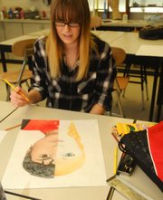 Sophia Brich works to complete a colored-pencil drawing of herself and Michael Jackson. It is one of a series of 12 self-portraits she will complete as a requirement in a Baldwin HIgh School advanced placement class.