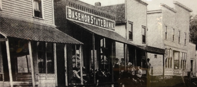 An old photo of what is now 155th Street that hangs in the Basehor Historical Museum. The buildings depicted were burnt down in several Basehor fires that nearly wiped out the city's former business district.