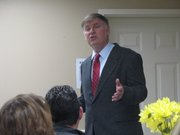 Mayor David Breuer speaks at the state of the city address on Thursday at the Community National Bank in Basehor.