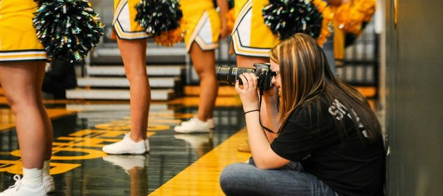 Cassie Batesel taking photos at a BLHS basketball game earlier this year.