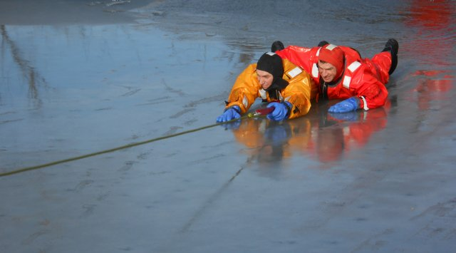 Shawnee firefighters take turns practicing ice-rescue techniques at Shawnee Mission Park Lake.