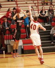 Jonah Freese shoot a 3-pointer in Bonner Springs' 64-56 win Thursday at Tonganoxie.
