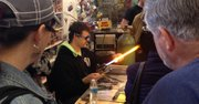 Sammy Flowers uses a flame to create a dichroic galaxy marble Saturday at Marble Crazy 2014.