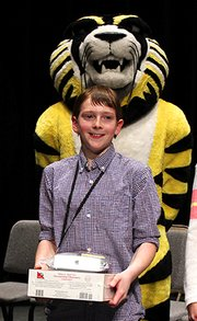 Sterling Holland smiles after winning the 2013 Sunflower Spelling Bee. He won again this year and will travel to Washington, D.C., in May for the Scripps National Spelling Bee.