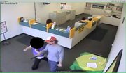 The suspect in Saturday's robbery leads the clerk to lock the front door, brandishing a gun.