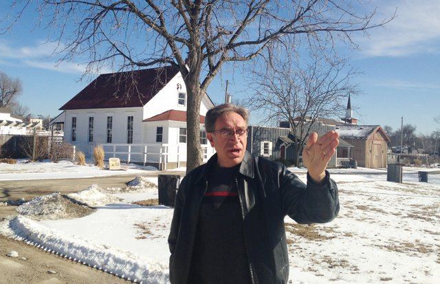 Charlie Pautler points to areas of future expansion for Shawnee Town 1929.