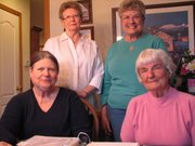 (Top Row) Judy Ward and Karen Meredith stand with Jean Pinick and Connie Puttholf in Meredeth's home in Tonganoxie. The women are four of the 12 charter women who began the Ephriam Basehor Chapter of the DAR.