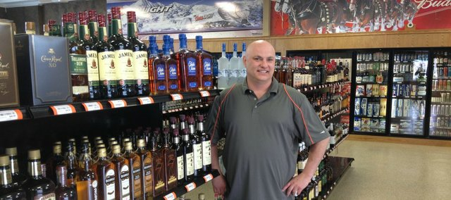 Scott Bohannon stands in the new Bohannon's Wine and Spirits Liquor store, 15518 Pinehurst Drive.