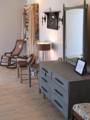 The Krouse House's store lined with refinished and custom book shelves, desks, chairs and chest of drawers.