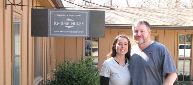 Todd and Tara Krouse stand outside of their new business in Basehor, Krouse House, Furniture and Home Decor.