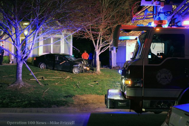 A car crashed through two fences and sideswiped a house before crashing head-on into a tree.