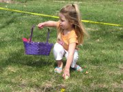 Janae Bacon, 3, gets off to a quick start at the annual Easter Egg Hunt at the Basehor City Park.