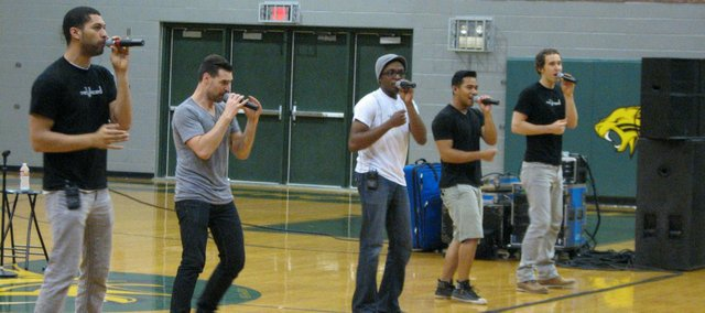 Members of re;Voiced perform Monday morning for students at Basehor-Linwood High School. The group is performing tonight at 7 p.m. at the high school. Tickets are $10.