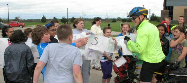 Ray Craighead is welcomed by fifth graders at Basehor Intermediate School after riding his bike for three days from Moberly, Missouri, to Basehor.