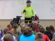 Ray Craighead speaks to fifth graders at Basehor Intermediate School about his bicycle journey along the Lewis and Clark trial.