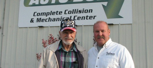 Don Tallman, 86, and his son Dan Tallman stand outside Tallman Auto & Body as they prepare to celebrate the 60th anniversary of the business this Saturday.