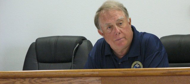 John Matthews listens to the city engineer's report at Tuesday's City Planning Commission meeting. Matthews announced that he was stepping down after 21 years on the commission on Tuesday.