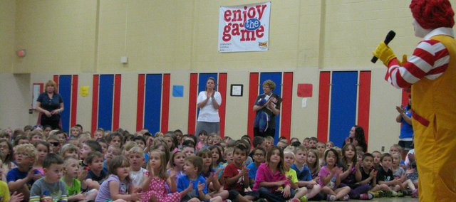 Students at Basehor Elementary School listen to Ronald McDonald on Monday during a surprise visit.