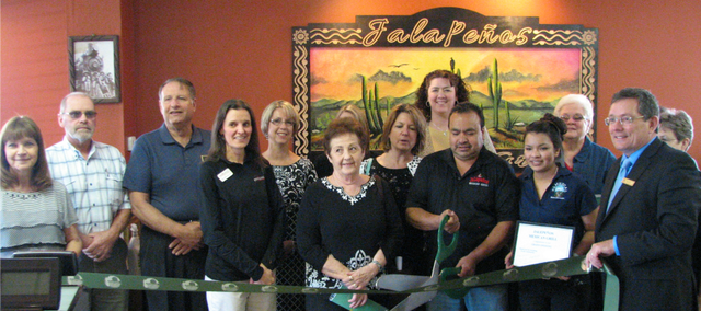 Francisco Mendez cuts the Basehor Chamber of Commerce ribbon last week as the chamber celebrated the restaurant's opening. Pictured are members of the Basehor Chamber of Commerce and employees of Jalapeños Mexican Grill.
