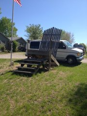 As you can tell from the full-sized van parked behind it, Kenny Wilcox made a mountain of an Adirondack chair.
