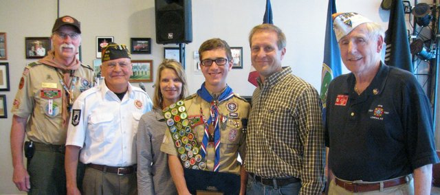 (From left to right) Boy Scout Troop 169 leader Bill Brown, Basehor VFW Post Commander Phil Jenkins, Roxann Storms, Jefferson Storms, Jeff Storms, and Kansas VFW scouting director Gerald Shirel at the presentation of Jefferson Storms runner-up Scout of the Year award.