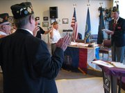 Larry Meadows installs the news officers at the Bsaehor VFW Post 11499. All of the positions remained the same from last year.