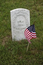 A tombstone shows military service but no birth year or death year. Online records show that William W. McWilliams served during the Civil War.