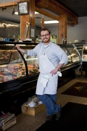 Stuart Aldridge is manager of the Broadway Butcher Shop in Kansas City, Mo., which offers creative menu items such as duck confit and octopus pastrami.
