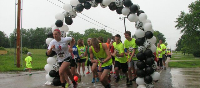 Runners begin the Crazy Cow 5k race at Saturday's Basehor Dairy Days. Despite the rain, about 80 runners came out to participate.