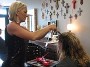 Amy Miller colors Liz Biggers' hair this week at Textür Salon in Basehor.