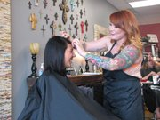 Mallorie Zule cuts Emily Staffore's hair at Textür Salon.